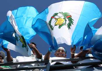 SAN DIEGO - JUNE 28:  Guatemala fans cheer and wave their flag before their team played Mexico in an international friendly match at Qualcomm Stadium on June 28, 2009 in San Diego, California.  (Photo by Stephen Dunn/Getty Images)
