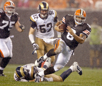 CLEVELAND - AUGUST 21:  Seneca Wallace #6 of the Cleveland Browns runs by David Vobora #58 of the St. Louis Rams at Cleveland Browns Stadium on August 21, 2010 in Cleveland, Ohio.  (Photo by Matt Sullivan/Getty Images)
