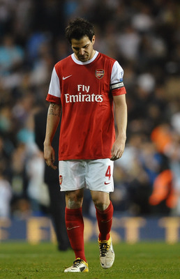 LONDON, ENGLAND - APRIL 20:  Cesc Fabregas of Arsenal walks off dejected after the Barclays Premier League match between Tottenham Hotspur and Arsenal at White Hart Lane on April 20, 2011 in London, England.  (Photo by Laurence Griffiths/Getty Images)
