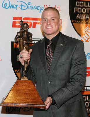 Drew Butler holding his 2009 Ray Guy Award