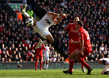 LIVERPOOL, UNITED KINGDOM - MARCH 06:  Javier Hernandez of Manchester United competes with Jamie Carragher of Liverpool during the Barclays Premier League match between Liverpool and Manchester United at Anfield on March 6, 2011 in Liverpool, England. (Ph