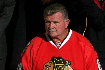 CHICAGO - APRIL 18:  Chicago Bears legend and Pro football Hall of Famer Mike Ditka stands on the ice prior to dropping the puck for the ceremonial face off between the Chicago Blackhawks and the Calgary Flames during Game Two of the Western Conference Qu