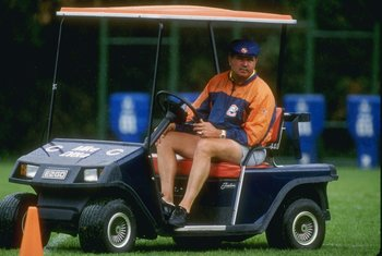 Jul 1990:  Head coach Mike Ditka of the Chicago Bears watches his team from a golf cart during Bears Training Camp at the University of Wisconsin-Platteville in Platteville, Wisconsin.  Mandatory Credit: Jonathan Daniel  /Allsport