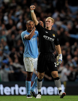 MANCHESTER, UNITED KINGDOM - MAY 10:  Joe Hart and Vincent Kompany (L) of Manchester City celebrate at the end of the Barclays Premier League match between Manchester City and Tottenham Hotspur at the City of Manchester Stadium on May 10, 2011 in Manchest