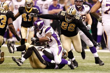 NEW ORLEANS - JANUARY 24:  Remi Ayodele #92 of the New Orleans Saints defends against the Minnesota Vikings during the NFC Championship Game at the Louisiana Superdome on January 24, 2010 in New Orleans, Louisiana. The Saints won 31-28 in overtime. (Photo