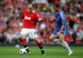 MANCHESTER, ENGLAND - MAY 08:  Wayne Rooney of Manchester United competes with Branislav Ivanovic of Chelsea during the Barclays Premier League match between Manchester United and Chelsea at Old Trafford on May 8, 2011 in Manchester, England.  (Photo by A