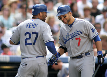 DENVER, CO - JUNE 12: Matt Kemp #27 of the Los Angeles Dodgers celebrates a solo home run in the fifth inning with teammate James Loney #7 against the Colorado Rockies on June 12, 2011 at Coors Field in Denver, Colorado. The Dodgers won the game 10-8. (Ph