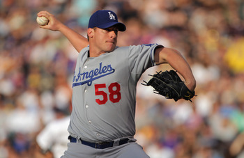 DENVER, CO - JUNE 10:  Starting pitcher Chad Billingsley #58 of the Los Angeles Dodgers delviers against the Colorado Rockies as he pitched 4 2/3  innings and left the game with the Rockies leading 6-0 at Coors Field on June 10, 2011 in Denver, Colorado.