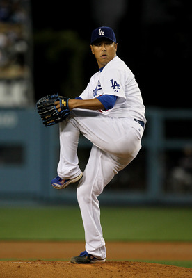 LOS ANGELES, CA - APRIL 19:  Hiroki Kuroda #18 of the Los Angeles Dodgers throws a pitch against the Atlanta Braves on April 19, 2011 at Dodger Stadium in Los Angeles, California.  (Photo by Stephen Dunn/Getty Images)
