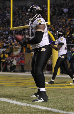 PITTSBURGH, PA - JANUARY 15:  Defensive end Cory Redding #93 of the Baltimore Ravens stands in the end zone after scoring on a fumble by the Pittsburgh Steelers during the AFC Divisional Playoff Game at Heinz Field on January 15, 2011 in Pittsburgh, Penns