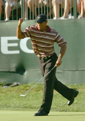 AKRON, OH - AUGUST 21:  Tiger Woods pumps his fists in celebration of a birdie on the 16th hole to put him at 6 under par and in the lead during the fourth round of the NEC Invitational at the Firestone Country Club on August 21, 2005 in Akron, Ohio.  Woo