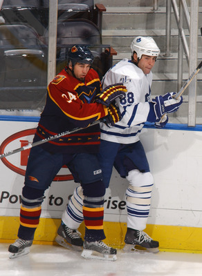 ATLANTA - DECEMBER 1:  Shane Hnidy #34 of the Atlanta Thrashers skates against Eric Lindros #88 of the Toronto Maple Leafs at Philips Arena on December 1, 2005 in Atlanta, Georgia. The Maple Leafs won 4-1. (Photo by: Scott Cunningham/Getty Images)