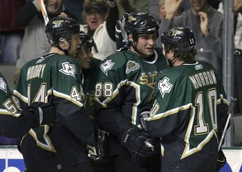 DALLAS - NOVEMBER 01:  Center Eric Lindros #88 of the Dallas Stars celebrates a goal with Brenden Morrow #10 during play against the St. Louis Blues at the American Airlines Center on November 1, 2006 in Dallas, Texas.  (Photo by Ronald Martinez/Getty Ima