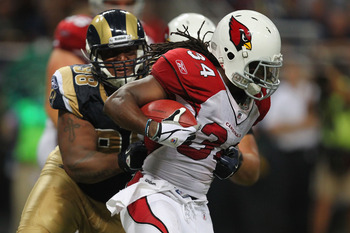 ST. LOUIS - SEPTEMBER 12: Tim Hightower #34 of the Arizona Cardinals is tackled by Fred Robbins #98 of the St. Louis Rams during the NFL season opener at the Edward Jones Dome on September 12, 2010 in St. Louis, Missouri.  The Cardinals beat the Rams 17-1