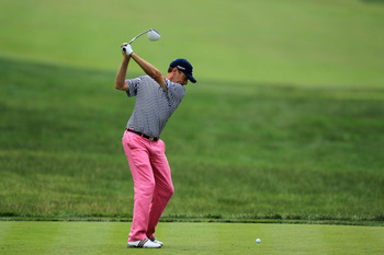 BETHESDA, MD - JUNE 16:  Davis Love III hits his tee shot on the ninth hole during the first round of the 111th U.S. Open at Congressional Country Club on June 16, 2011 in Bethesda, Maryland.  (Photo by David Cannon/Getty Images)