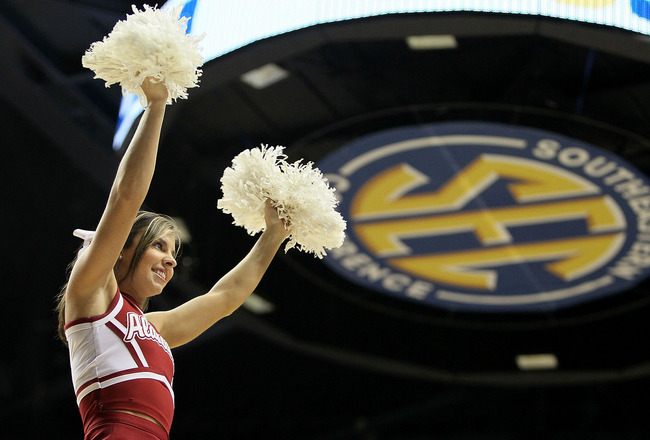 NASHVILLE, TN - MARCH 11: A cheerleader for the Alabama Crimson Tide performs against the South Carolina Gamecocks during the first round of the SEC Men's Basketball Tournament at the Bridgestone Arena on March 11, 2010 in Nashville, Tennessee.  (Photo by