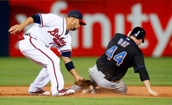 ATLANTA, GA - JUNE 15:  Jason Bay #44 of the New York Mets steals second base against Alex Gonzalez #2 of the Atlanta Braves in the second inning at Turner Field on June 15, 2011 in Atlanta, Georgia.  (Photo by Kevin C. Cox/Getty Images)