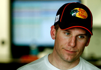 TALLADEGA, AL - APRIL 15:  Jamie McMurray, driver of the #1 Bass Pro Shops/Tracker Boats Chevrolet,  stands in the garage during practice for the NASCAR Sprint Cup Series Aaron's 499 at Talladega Superspeedway on April 15, 2011 in Talladega, Alabama.  (Ph