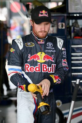 KANSAS CITY, KS - JUNE 03:  Brian Vickers, driver of the #83 Red Bull Toyota, stands in the garage area during practice for the NASCAR Sprint Cup Series STP 400 at Kansas Speedway on June 3, 2011 in Kansas City, Kansas.  (Photo by Tim Umphrey/Getty Images