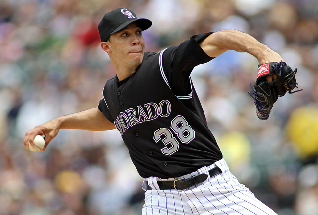 DENVER, CO - JUNE 12: Ubaldo Jimenez #38 of the Colorado Rockies pitches against the Los Angeles Dodgers on June 12, 2011 at Coors Field in Denver, Colorado. Jimenez has gotten off to a slow start in 2011 going 1-7 after winning 19 games last season. (Pho
