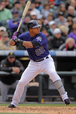DENVER, CO - MAY 01:  Third baseman Jose Lopez #22 of the Colorado Rockies takes an at bat against the Pittsburgh Pirates at Coors Field on May 1, 2011 in Denver, Colorado. The Pirates defeated the Rockies 8-4.  (Photo by Doug Pensinger/Getty Images)