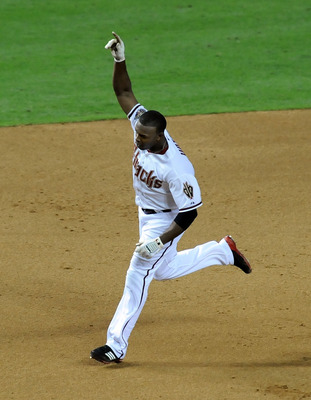 PHOENIX - JUNE 16:  Justin Upton #10 of the Arizona Diamondbacks holds his hand in the air after hitting a walk off home run against the San Francisco Giants at Chase Field on June 16, 2011 in Phoenix, Arizona.  (Photo by Norm Hall/Getty Images)