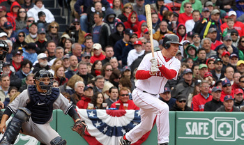 BOSTON, MA - APRIL 8:   J.D. Drew #7 of the Boston Red Sox knocks knocks in two runs with a single in the seventh inning against the New York Yankees on Opening Day at Fenway Park on April 8, 2011 in Boston, Massachusetts. (Photo by Jim Rogash/Getty Image