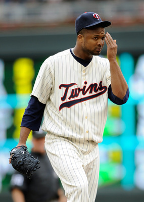 MINNEAPOLIS, MN - JUNE 12: Francisco Liriano #47 of the Minnesota Twins reacts to giving up a hit to Adrian Beltre #29 of the Texas Rangers during the eighth inning of their game on June 12, 2011 at Target Field in Minneapolis, Minnesota. Twins defeated t