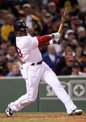 BOSTON, MA - MAY 22:  Mike Cameron #23 of the Boston Red Sox hits an RBI single in the fourth inning against the Chicago Cubs on May 22, 2011 at Fenway Park in Boston, Massachusetts.  Before this series, the two teams haven't played at Fenway Park since t