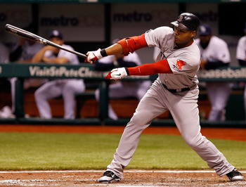 ST PETERSBURG, FL - JUNE 14:  Outfielder Carl Crawford #13 of the Boston Red Sox fouls off a pitch against the Tampa Bay Rays during the game at Tropicana Field on June 14, 2011 in St. Petersburg, Florida.  (Photo by J. Meric/Getty Images)