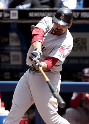 TORONTO, CANADA - JUNE 12:  Adrian Gonzalez #28 of the Boston Red Sox homers off of Kyle Drabek during MLB action at The Rogers Centre June 12, 2011 in Toronto, Ontario, Canada. (Photo by Abelimages/Getty Images)