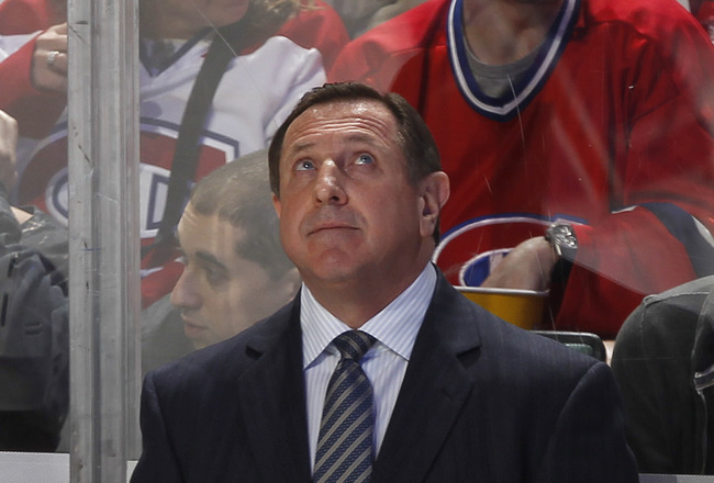 SUNRISE, FL - MARCH 3: Head coach Jacques Martin of the Montreal Canadiens watches a replay during a break in action against the Florida Panthers on March 3, 2011 at the BankAtlantic Center in Sunrise, Florida. The Canadiens defeated the Panthers 4-0. (Ph