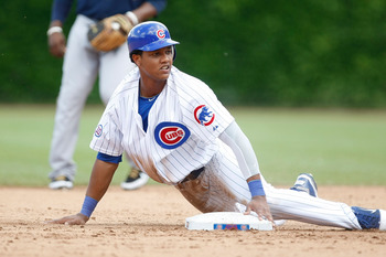 CHICAGO, IL - JUNE 16: Starlin Castro #13 of the Chicago Cubs slides into second base against the Milwaukee Brewers at Wrigley Field on June 16, 2011 in Chicago, Illinois. (Photo by Scott Boehm/Getty Images)