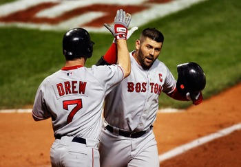 CLEVELAND - OCTOBER 15:  Jason Varitek #33 of the Boston Red Sox celebrates with J.D. Drew #7 after scoring him with a two-run home run in the seventh inning against the Cleveland Indians during Game Three of the American League Championship Series at Jac
