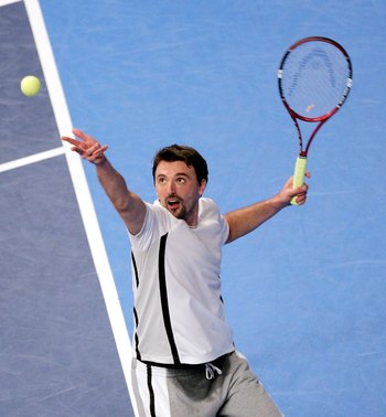 LONDON - DECEMBER 08:  Goran Ivanisevic of Croatia in serves against Jeremy Bates of Great Britain during The BlackRock Masters at the Royal Albert Hall on December 8, 2006 in London, England.  (Photo by Christopher Lee/Getty Images)