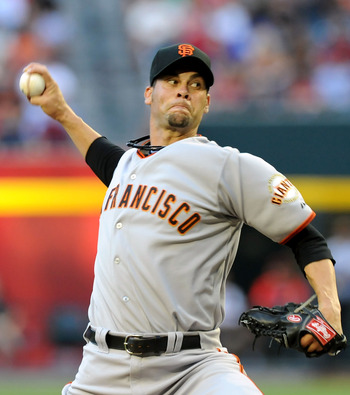 PHOENIX - JUNE 16:  Pitcher Ryan Vogelsong #32 of the San Francisco Giants throws against the Arizona Diamondbacks at Chase Field on June 16, 2011 in Phoenix, Arizona.  (Photo by Norm Hall/Getty Images)