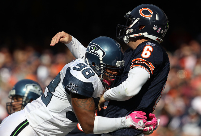 CHICAGO - OCTOBER 17: Jay Cutler #6 of the Chicago Bears is hit after throwing by Raheem Brock #98 of the Seattle Seahawks at Soldier Field on October 17, 2010 in Chicago, Illinois. The Seahawks defeated the Bears 23-20. (Photo by Jonathan Daniel/Getty Im