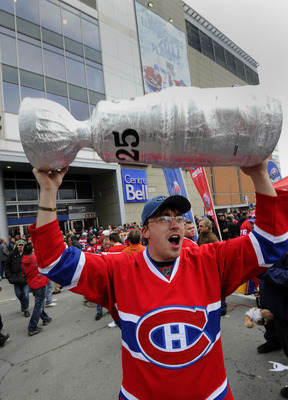 MONTREAL, CANADA - APRIL 18:  Jean-Francois Boudreau celebrates with other fans before Game Three of the Eastern Conference Quarterfinals between the Boston Bruins and the Montreal Canadiens during the 2011 NHL Stanley Cup Playoffs at the Bell Centre on A