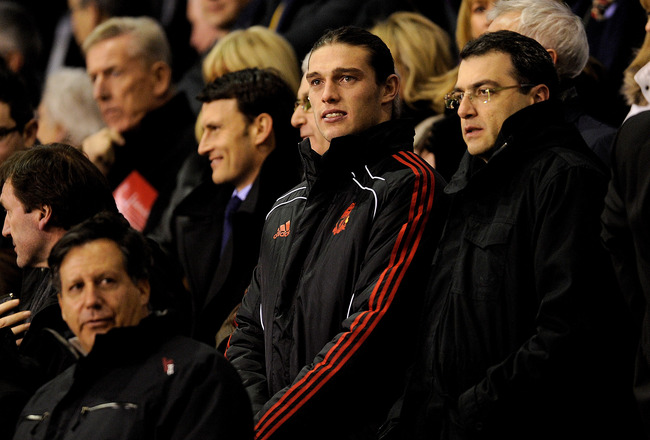 LIVERPOOL, ENGLAND - FEBRUARY 02:  New Liverpool signing Andy Carroll watches from the stands with Chairman Tom Werner (L) and Director of Football Strategy Damien Comolli (R) prior to the Barclays Premier League match between Liverpool and Stoke City at