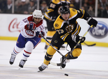 BOSTON, MA - APRIL 16:  Michael Ryder #73 of the Boston Bruins heads for the net as Scott Gomez #11 of the Montreal Canadiens defends in Game Two of the Eastern Conference Quarterfinals during the 2011 NHL Stanley Cup Playoffs at TD Garden on April 16, 20