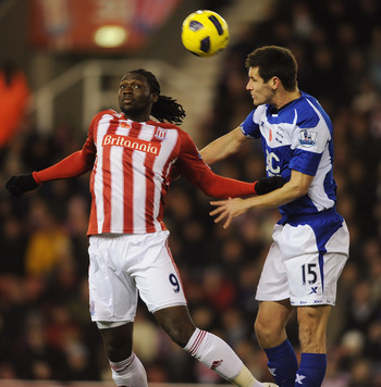 STOKE ON TRENT, ENGLAND - NOVEMBER 09:  Kenwyne Jones of Stoke in action with Scott Dann of Birmingham during the Barclays Premier League match between Stoke City and Birmingham City at the Britannia Stadium on November 9, 2010 in Stoke on Trent, England.