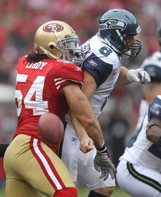 SAN FRANCISCO - DECEMBER 12:  Travis LaBoy #54 of the San Francisco 49ers sacks Matt Hasselbeck #8 of the Seattle Seahawks during an NFL game at Candlestick Park on December 12, 2010 in San Francisco, California.(Photo by Jed Jacobsohn/Getty Images)