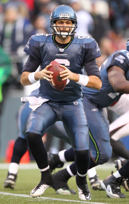 SEATTLE, WA - DECEMBER 19:  Quarterback Charlie Whitehurst #6 of the Seattle Seahawks looks to pass against the Atlanta Falcons at Qwest Field on December 19, 2010 in Seattle, Washington. (Photo by Otto Greule Jr/Getty Images)