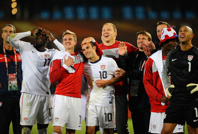 PRETORIA, SOUTH AFRICA - JUNE 23:  (L-R) Jozy Altidore, Stuart Holden, Landon Donovan and Tim Howard of the United States celebrate with team mates, the victory that sends the USA through to the second round in the 2010 FIFA World Cup South Africa Group C