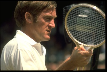 1970's:  TONY ROCHE OF AUSTRALIA EXAMINES HIS RACQUET DURING A MATCH AT THE WIMBLEDON TENNIS CHAMPIONSHIPS.
