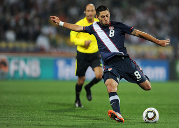 RUSTENBURG, SOUTH AFRICA - JUNE 12:  Clint Dempsey of the United States shoots and scores during the 2010 FIFA World Cup South Africa Group C match between England and USA at the Royal Bafokeng Stadium on June 12, 2010 in Rustenburg, South Africa.  (Photo
