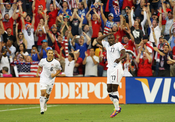 KANSAS CITY, MO - JUNE 14:  Jozy Altidore #17 of the USA celebrates alongside Steve Cherundolo #6 after scoring a goal during the first half of the GoldCup game against Guadeloupe on June 14, 2011 at LiveStrong Sporting Park in Kansas City, Kansas.  (Phot