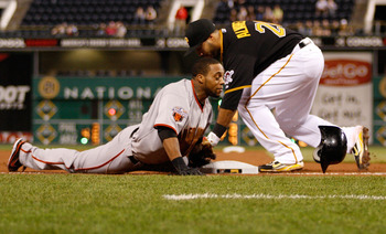 PITTSBURGH - APRIL 26:  Darren Ford #34 of the San Francisco Giants slides safely into third base past the tag of Pedro Alvarez #24 of the Pittsburgh Pirates during the game on April 26, 2011 at PNC Park in Pittsburgh, Pennsylvania.  (Photo by Jared Wicke