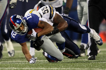 EAST RUTHERFORD, NJ - NOVEMBER 08:  Steve Smith #12 of the New York Giants is tackled Brandon Siler #59 of the San Diego Chargers at Giants Stadium on November 8, 2009 in East Rutherford, New Jersey.  (Photo by Nick Laham/Getty Images)