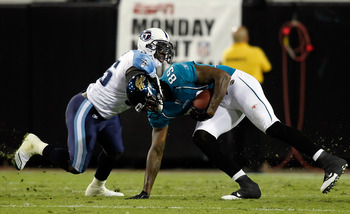 JACKSONVILLE, FL - OCTOBER 18:  Receiver Marcedes Lewis #89 of the Jacksonville Jaguars is tackled by linebacker Stephen Tulloch #55 of the Tennessee Titans during the game at EverBank Field on October 18, 2010 in Jacksonville, Florida.  (Photo by J. Meri